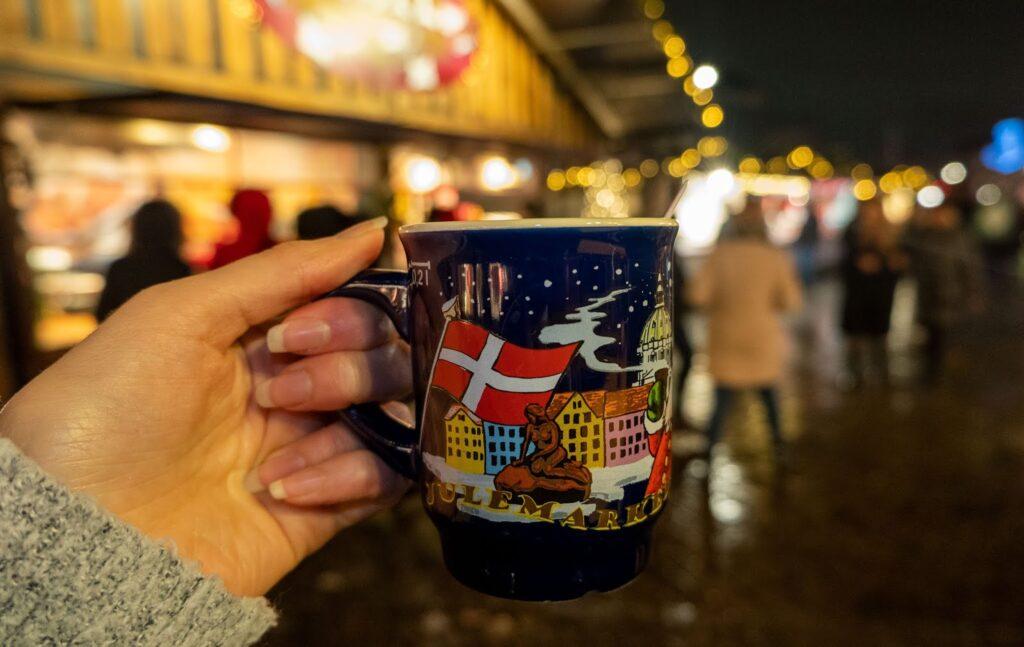 Holding my souvenir Copenhagen Christmas Market mug at the Kongens Nytorv Christmas Market