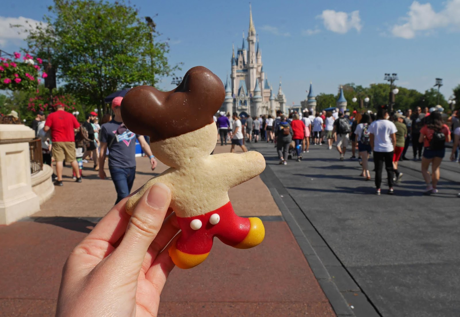 Eating a Mickey Mouse cookie at Disney's Magic Kingdom on our 4 park challenge day