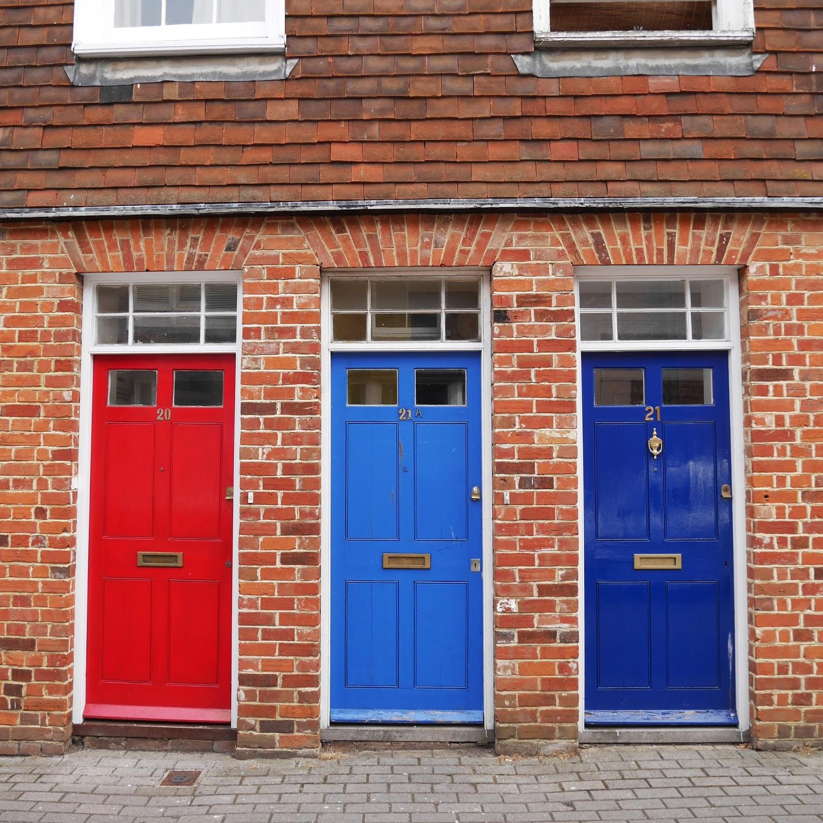 Painted doors on Love Lane in Canterbury, Kent